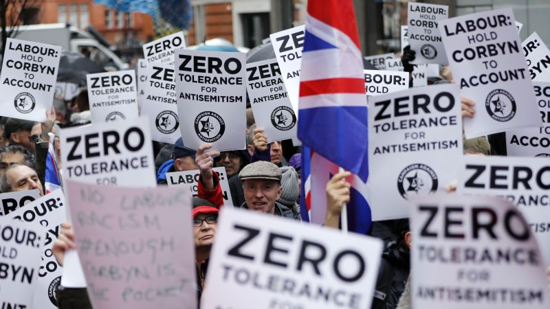 People gather for a demonstration organized by the Campaign Against Antisemitism outside the head office of the British opposition Labour Party in central London on April 8, 2018.