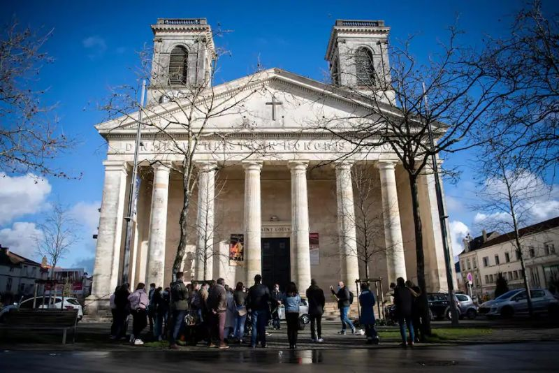 University of Nantes lecturer Olivier Ertzscheid speaks in a square outside a church in La Roche-sur-Yon, western France, on Dec. 15. (Loic Venance/AFP/Getty Images)