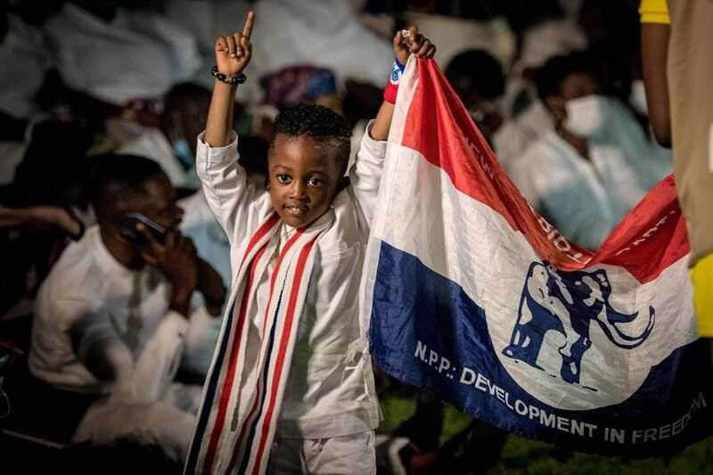 A child holds a flag of the New Patriotic Party (NPP) after Nana Akufo-Addo was declared president of Ghana by the Electoral Commission in Accra on Dec. 9. (Cristina Aldehuela/AFP/Getty Images)