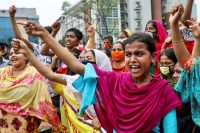 Garment workers in Dhaka, Bangladesh, blocked a highway in April at a protest demanding their wages, which went unpaid during a nationwide coronavirus lockdown that forced most factories to suspend operations. Credit Mohammad Ponir Hossain/Reuters