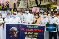 Catholic priests and nuns in Secunderabad, India protest against the arrest of Father Stan Swamy in October. Credit Noah Seelam/Agence France-Presse — Getty Images