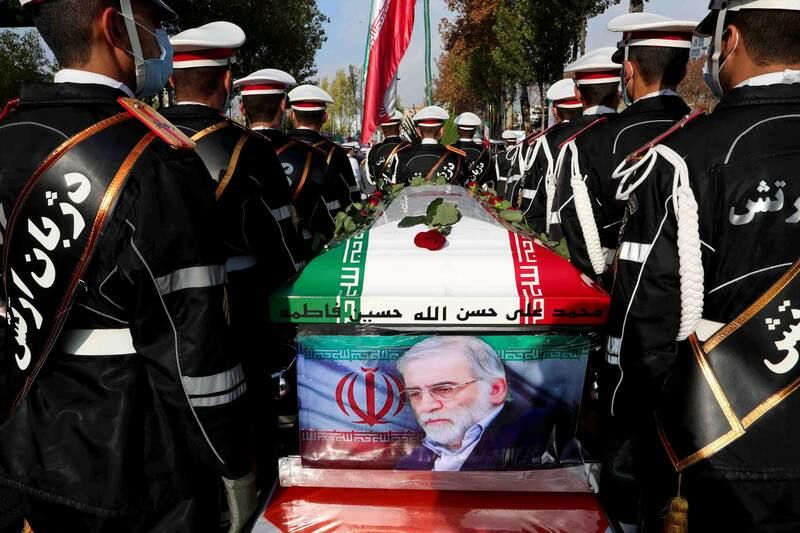 Members of Iranian forces carry the coffin of Iranian nuclear scientist Mohsen Fakhrizadeh during a funeral ceremony in Tehran on Nov. 30. (Iranian Defense Ministry/WANA/Reuters)