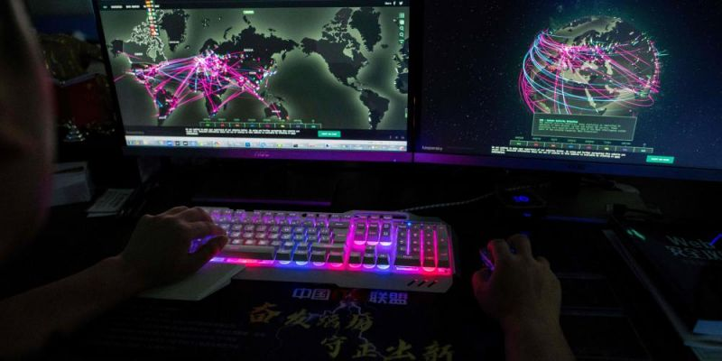 Hacking group Red Hacker Alliance use website monitoring global cyberattacks in Dongguan, China. Photo by NICOLAS ASFOURI / AFP.