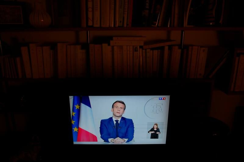 French President Emmanuel Macron delivers a televised address to the nation on Thursday, following the death of former president Valéry Giscard d'Estaing. (Christophe Ena/AP)