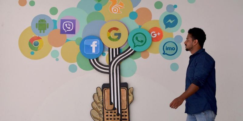 Mural depicting the influence of various social media platforms in Bangalore, India. Photo by MANJUNATH KIRAN/AFP via Getty Images.