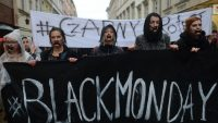 Women wearing black participate in a nationwide pro-abortion protest on 3 October 2016 in Warsaw, Poland. The protest, called Black Monday, opposes the tightening of anti-abortion laws by the Polish government. Photo: Getty Images.