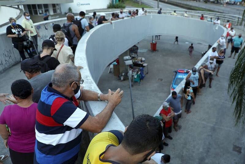 People line up to vote during Brazil's second round of municipal elections at a polling station in Rio de Janeiro on Nov. 29. (Fabio Motta/EPA-EFE/REX/Shutterstock)