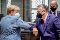 Chancellor Angela Merkel of Germany and Prime Minister Viktor Orban of Hungary arriving for a European summit in October. Credit Pool photo by Olivier Hoslet