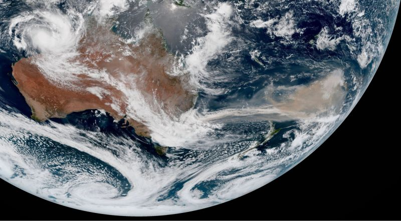 A closer view of Australia's smoke plume on Jan. 6. Partially hidden by clouds, New Zealand is visible below the plume's center. Credit Michael Benson/Japanese Meteorological Agency