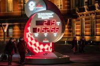 People walk past a countdown clock for the postponed Tokyo 2020 Olympic Games outside Tokyo railway station on Dec. 16. (Philip Fong/AFP via Getty Images)