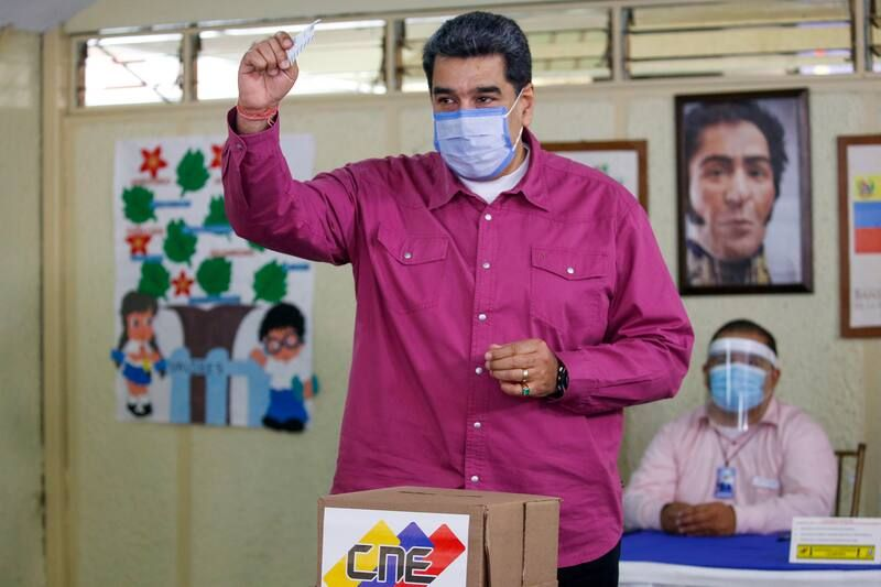 President Nicolás Maduro shows his ballot during elections to choose members of the National Assembly in Caracas, Venezuela, on Sunday. (Ariana Cubillos/AP)
