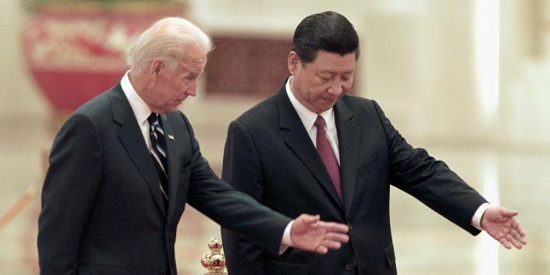 Xi Jinping meets Joe Biden at a welcoming ceremony inside the Great Hall of the People in Beijing, China. Photo by Lintao Zhang/Getty Images.