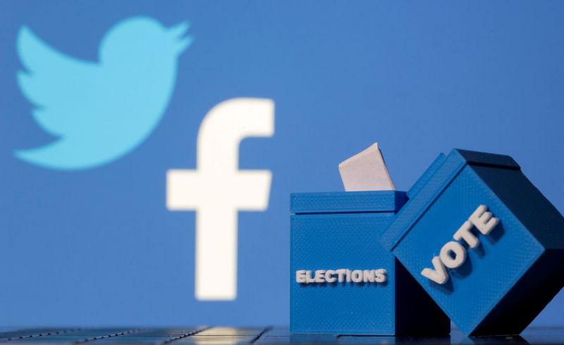 Urnas de votos frente a los logos de Facebook y Twitter.DADO RUVIC / Reuters