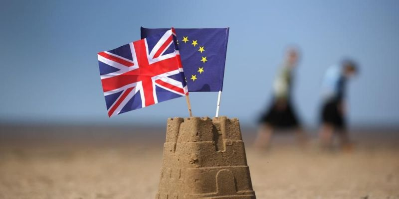 Flags of the European Union and the UK on a sand castle in Southport, United Kingdom. Photo by Christopher Furlong/Getty Images.