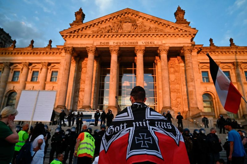 Protesters gathered in front of the the Reichstag in Berlin on Aug. 29. Credit John Macdougall/Agence France-Presse — Getty Images