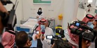The first Saudi citizen to receive the Pfizer-BioNTech COVID-19 vaccine speaks to reporters at a vaccination centre supervised by the health ministry in the capital Riyadh. Photo by FAYEZ NURELDINE/AFP via Getty Images.