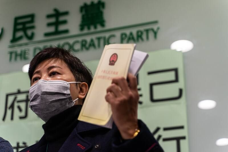 Helena Wong, former pro-democracy lawmaker who was released on bail after being arrested for subversion under the city's national security law, holds a legal document during a news conference in Hong Kong on Friday. (Chan Long Hei/Bloomberg)