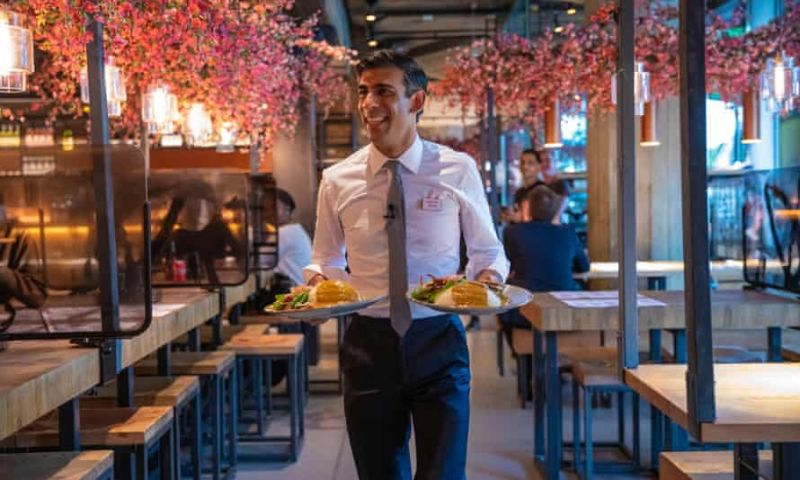 'The image of a maskless Rishi Sunak serving meals in a London Wagamama to launch August's 'eat out to help out' initiative has not aged well.' Photograph: Simon Walker/HM Treasury