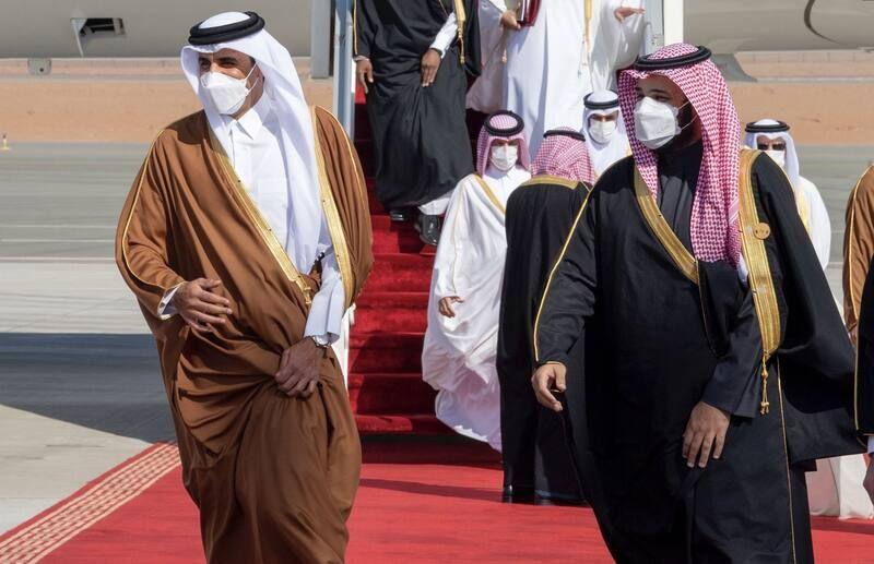 Prince Mohammed bin Salman, right, welcomes Qatar's Sheikh Tamim Bin Hamad al-Thani in Al Ula, Saudi Arabia on Jan. 5. (Getty Images Agency/Anadolu) (Anadolu Agency/Anadolu Agency via Getty Images)