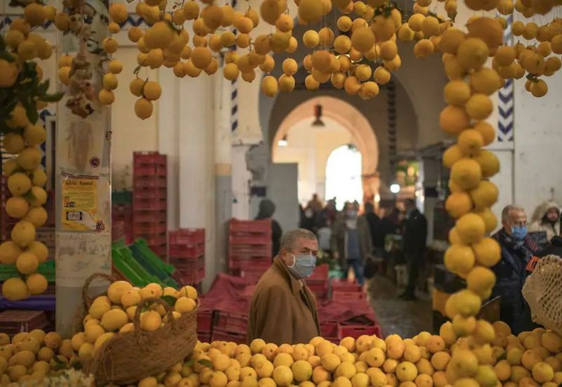 A man walks in the central market in Tunis on Wednesday, a day before a national lockdown and the 10th anniversary of the uprising that toppled longtime autocrat Zine el-Abidine Ben Ali. (Mosa'ab Elshamy/AP)