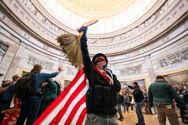Pro-Trump rioters run through the Rotunda of the U.S. Capitol after breaching Capitol security on Jan. 6. (Jim Lo Scalzo/EPA-EFE/Shutterstock)