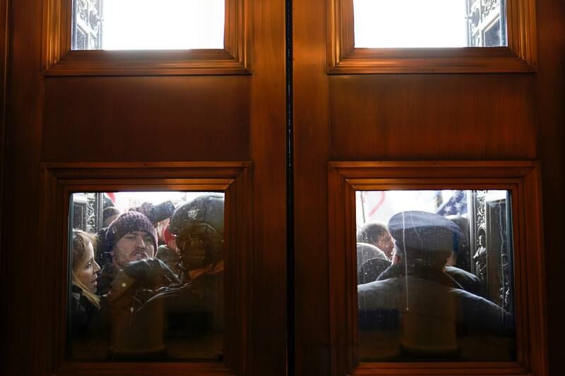 U.S. Capitol Police try to hold back pro-Trump protesters outside the east doors to the House side of the U.S. Capitol. (Andrew Harnik/AP)