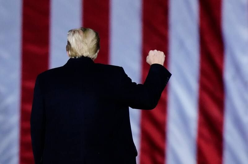 President Trump speaks at a campaign rally in support of Republicans Kelly Loeffler and David Perdue in Dalton, Ga., on Jan. 4, ahead of the runoff elections for U.S. Senate seats. (Brynn Anderson/AP)