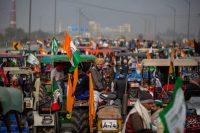 Indian farmers protesting new farm laws outside New Delhi. Credit Altaf Qadri/Associated Press