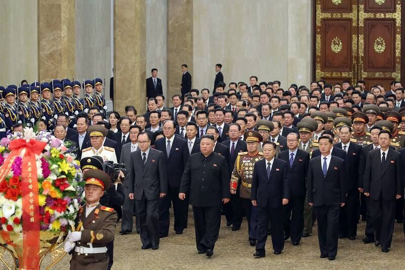 Kim Jong Un, along with newly elected party leaders, in Pyongyang on Jan. 12. (Str/AFP/Getty Images)