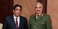 President of Libya's interim government Mohammad Younes Menfi (L) meets warlord Khalifa Haftar (R) in Benghazi, Libya on 11 February 2021. Photo by Khalifa Haftar Forces Press Office/Handout/Anadolu Agency via Getty Images.