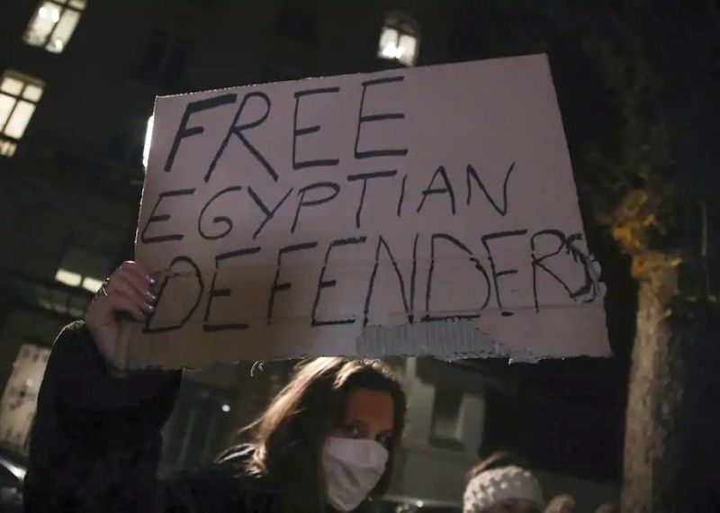 A woman holds a placard as she protests against Egyptian President Abdel Fatah al-Sissi in Paris on Dec. 8, 2020. (Michel Euler/AP)