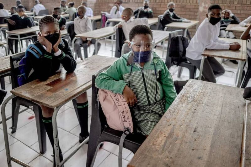 Students from Ithute Higher Primary School sit in their classroom during the first day of the new academic year in Johannesburg on Feb. 15. Across Africa, tax deficits limit government resources for health care, education and post-pandemic economic recovery efforts. (Luca Sola/AFP/Getty Images)