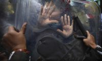 Police using riot shields push back farm-law protesters in Delhi on 3 February. Photograph: Manish Swarup/AP