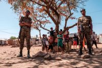 Ethiopian Army soldiers stand near children at the Mai Aini refugee camp in Ethiopia on Jan. 30. (Eduardo Soteras/AFP/Getty Images)