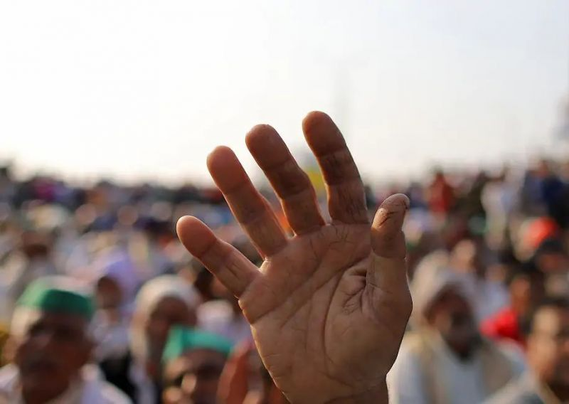 A farmer holds a hand up during a demonstration against recent agricultural reforms at a highway in Ghazipur on the outskirts of New Delhi on Saturday. (Anindito Mukherjee/Bloomberg News)
