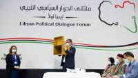 A UN official shows the ballot box to participants of the UN-hosted Libyan Political Dialogue Forum in Geneva, 5 February 2021. UNSMIL