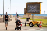 A sign announcing a state government lockdown due to covid-19 is seen at Scarborough Beach in Perth, Australia, on Monday. (Richard Wainwright/EPA-EFE/REX/Shutterstock)