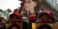 People hold up images of Aung San Suu Kyi at a protest outside Myanmar's embassy in Bangkok, Thailand on 1 February, 2021. Photo by Lauren DeCicca/Getty Images