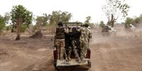 Members of the Nigerian military patrol the streets of Gwoza, Boko Haram's base in northern Nigeria, recently retaken by the Nigerians, on 8 April 2015. Photo: Jane Hahn for the Washington Post via Getty Images.