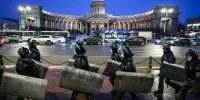 Riot police outside the Kazan Cathedral in Saint Petersburg after Russian opposition activist Alexei Navalny was sentenced to a jail term. Photo by Peter Kovalev\TASS via Getty Images.