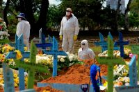Gravediggers are seen at a funeral of a covid-19 victim at the Nossa Senhora Aparecida cemetery in Manaus, Brazil, last month. (Marcio James/AFP/Getty Images)