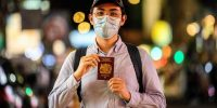 Reese Tan poses with his British National (Overseas) passport in his favourite part of Hong Kong, the shopping and eating district of Mongkok. Photo by ANTHONY WALLACE/AFP via Getty Images.