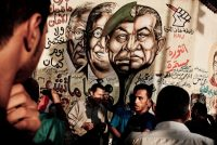 A mural in Cairo in 2012 depicted President Hosni Mubarak of Egypt and former ministers after he was deposed in the Arab Spring. Credit Tomas Munita for The New York Times
