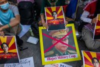 Protesters sit outside the Russian embassy on Friday in Yangon, Myanmar. (Hkun Lat/Getty Images)