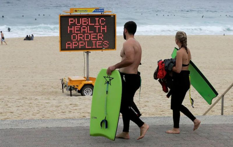 A sign warns people at a beach in Sydney on Dec. 19. (Mark Baker/AP)