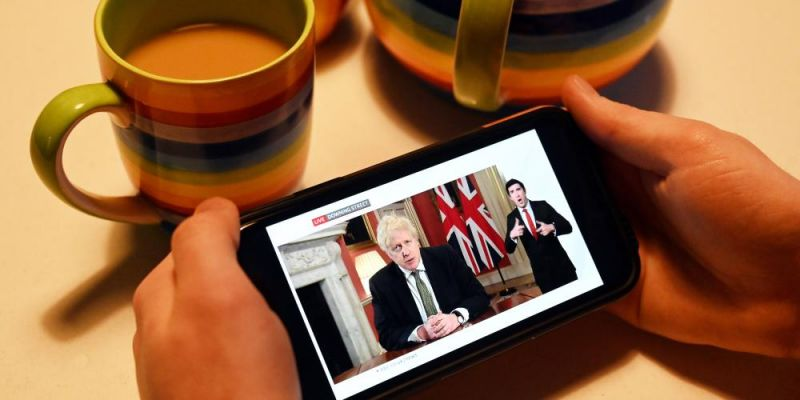 Drinking tea while UK prime minister Boris Johnson gives a televised message to the nation from 10 Downing Street in London. Photo by PAUL ELLIS/AFP via Getty Images.