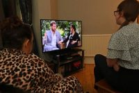 Television viewers in Liverpool, England, watch Prince Harry and Meghan Markle's interview with Oprah Winfrey. (Paul Ellis/AFP via Getty Images)
