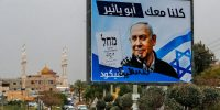 A defaced electoral poster for Israeli prime minister and candidate, Benjamin Netanyahu, in the Arab city of Kfar Qassem in central Israel, on 22 March 2021. Photo by AHMAD GHARABLI/AFP via Getty Images.
