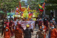 Buddhist monks lead a protest march supporting the Committee Representing Pyidaungsu Hluttaw, a Myanmar government-in-exile representing lawmakers ousted in February's military coup, in Mandalay, Myanmar, on Wednesday. (Str/AP)