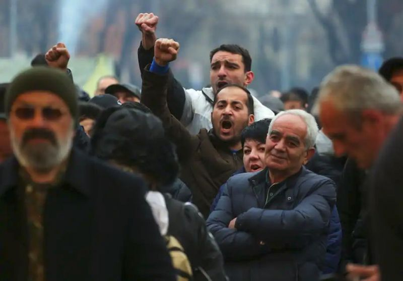Opposition demonstrators rally to pressure Armenian Prime Minister Nikol Pashinyan to resign in Yerevan, Armenia, on March 1. (Hrant Khachatryan/PAN/AP)